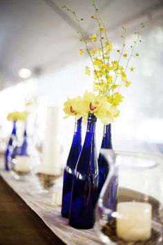I have blue bottles we can put sunflowers in as another option for centerpiece