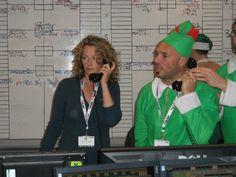Kate Humble and an elf closing a deal #icapcharityday #lgfbuk