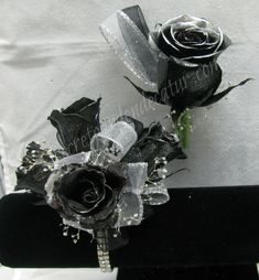 Tinted black roses with silver tips make this matching set unique and different.  Shown here with silver ribbon and on our sophisticated lady corsage bracelet.  $47.99 for the set ~ The Secret Garden in Decatur wants to be your Prom headquarters.