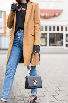 Camel Coat - Metallica Shirt - Louis Vuitton Twist Bag - V-Neck Pumps -Fishnet Socks