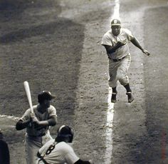 Jackie Robinson steals home against Yogi Berra & the NY Yankees, 1955 World Series. After losing the series eight times, the last five times against the Yankees, the Brooklyn Dodgers beat the Bombers to win their first World Series ever. After losing the first two games, they went on to win the next four. No team has ever done that before.