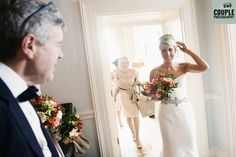 A very proud Father of the bride sees his daughter in her wedding dress. Weddings at Durrow Castle photographed by Couple Photography.