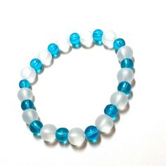 Blue and clear glass bead bracelet Blue and clear glass bead bracelet the clear beads are frosted stretchy suitable for wrists of 7 1/2 inches or less Jewelry Bracelets