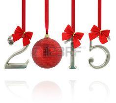 2015 ornamentos. Número 2015 colgando de cintas rojas. Foto de archivo.