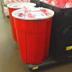 Paint a trash can red on the outside & white on the inside & you have your own Red Solo Cup! Would make a great cooler, or use for beer pong using a beach ball.