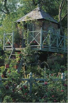 What an awesome little treehouse for your garden!