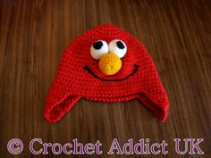 Elmo Hat with Ear Flaps 3yrs +           The pattern is in US terms     Items required   4mm (6) and 5mm (H) hook.  If you don't have a 4m...