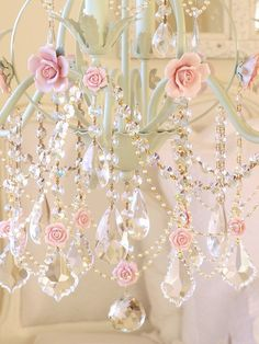 Pink roses on crystal chandelier
