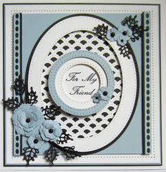 Hello bloggers!  Today's card offering comes from the September release dies.  I started by cutting an oval frame using both the  Double...