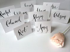 Calligraphy wedding name place cards on Etsy, $18.56 AUD