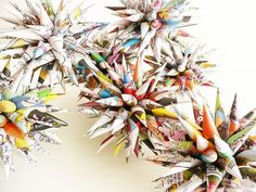 These upcycled paper Polish star ornaments are made from recycled, color newspaper