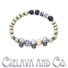 This bracelet features lava rock beads, alloy beads, cz crystals ball, and three skull charm all strung along an elastic nylon for one trendy design.