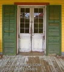 Just gorgeous Porch Doors with Shutters.