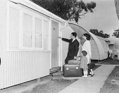 A migrant family enters their new home at Maribyrnong, Victoria, 1965. Nissen huts were a common feature of life in a 'silver city'