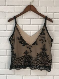 Spaghetti strap top is a fashion essential. Shimmering Floral sequin graphic makes you stand out among crowd!