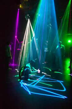 A new exhibition at The Barbican uses computer-controlled lasers to let visitors create beautiful, ever-changing light-sculptures and draw colorful patterns on the floor