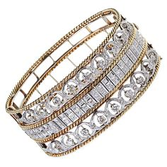 Fine Diamond and Gold Cord Wide Bangle | From a unique collection of vintage bangles at https://www.1stdibs.com/jewelry/bracelets/bangles/
