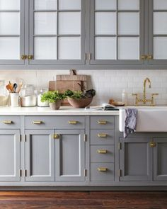 brass with grey cabinets. swoon.