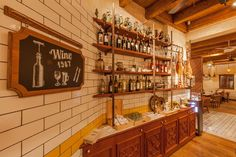 Iberico Tapas Bar is a project completed by PickTwo Studio in Craiova, Romania. Spanish Inspired, Iberico Tapas Bar is located in an old reconditioned house Tapas Bar, Bar Drinks, Classic House, Liquor Cabinet, Old Things, Flooring, Interior Design, Storage, Wall