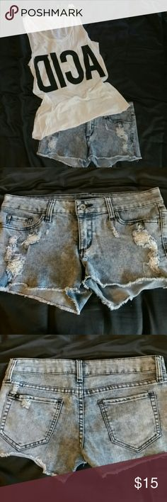 Short shorts acid wash with distressing in size 5 Acid wash shorts very stretchy with distressing barely worn they have skull detail on inside pocket. Shorts
