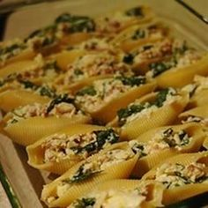 This is a delicious baked pasta dish with large shells filled with meat, spinach and cheese that children always seem to love. It is kind of a 'spaghetti that behaves itself!'