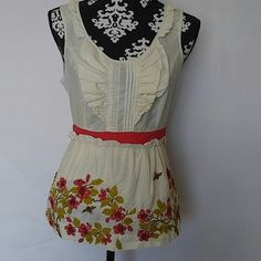 """Anthro Floreat Tie Back Top Floreat Top? Tie Back with side zipper? Ivory with red and green floral print with bumble bees? Ruffle detail at bust? 100% cotton? Fully lined? Size 4? Worn once or twice EUC? Measurements laying flat:? Shoulder to shoulder: 13.5""""? Underarm to underarm: 17""""? Length: 24""""? Waist: 14.5"""" Anthropologie Tops"""