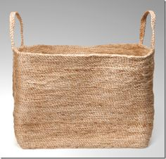 stylish woven basket to put rolled up, white bathroom towels in
