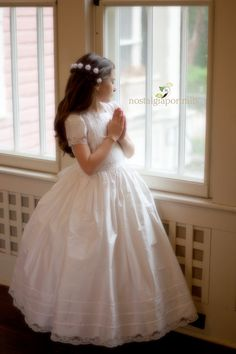 an adorable pose I would love for my son's portraits as Emily Grace -- we love this style dress too