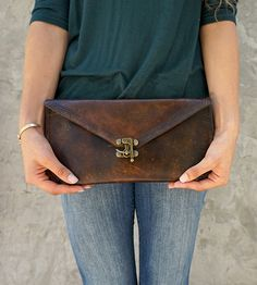 Small Leather Envelope Clutch by Reagan & Rose  on Scoutmob. Dyed, stitched and finished by hand, the clutch features a triangle pattern stamped on the flap, for a bit of western-inspired flair.