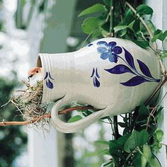 """Bird bottles, called """"martin-pots"""" in colonial times, were hung beneath the eaves of buildings to encourage martins and other small birds to roost there and help with insect control. Garden Bird Feeders, Bird House Feeder, Bird House Kits, Bird Aviary, Glazes For Pottery, Glazed Pottery, Small Birds, Wild Birds, Outdoor Projects"""