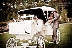 Wedding photo taken in the white carriage at Brigalias
