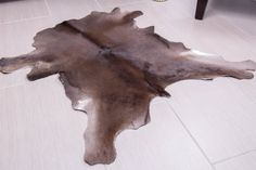 Exotic Leather Carpet hair on animal skin rug by Rodeocowhides