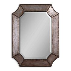 The authentic, rustic patina of the hammered aluminum frame lends this mirror vintage industrial charm.