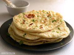 Soft, pillowy, homemade naan is easier to make than you think and it's great for sandwiches, pizza, dipping, and more. Step by step photos.