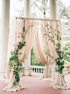 Simple white draping with greenery on the sides