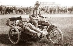 WWI sidecar Ambulance. I love the horses in the background.