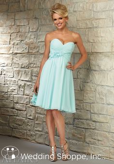 Stunning strapless chiffon bridesmaid dress with floral detail.