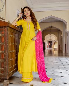 Sun Bandhej Kurta Set – Aachho Yellow Rayon Kurta Set adorned with Gota detailing, The set comes with the contrast Pink Bandhej Chiffon Gota Dupatta. Indian Long Dress, Dress Indian Style, Indian Dresses, Designer Party Wear Dresses, Indian Designer Outfits, Eid Outfits, Fashion Outfits, Yellow Kurti, Sleeves Designs For Dresses