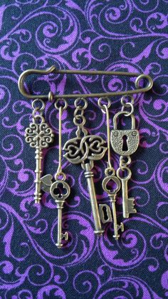Kilt Pin Brooch/Handbag Charm/Scarf Pin (50mm) with 5 Key Charms in antique bronze tone by RustyJools on Etsy