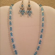 Blue Swarovski crystal Set The composition of this set has Blue Bicone Swarovski Crystals, Irredescent Diamond Cut Clear Crystals, and a Sterling Silver Toggle Clasp. This necklace set can be worn in any special occasion. Jewelry