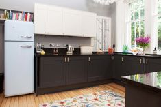 The Pink House kitchen makeover after photo, blue Smeg fridge, Cole & Son Woods wallpaper, Buster + Punch brass handles Victorian Terrace House, Victorian Homes, Black Kitchens, Home Kitchens, Kitchen Black, Home Decor Kitchen, Kitchen Design, Kitchen Ideas, Before After Kitchen