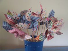 Pinwheels (just paper, 6mm dowel, a bead and map pin) made for the Arts & Craft stall of school fete.