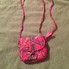 Vera Bradley very mini bag Mini bag, great condition, pretty pink pattern, a place for 2 cards inside, zips closed, can put the strap around the back to be used around your waist. Vera Bradley Bags Mini Bags