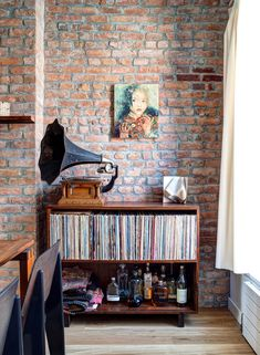 Find and explore exposed brick interior wall ideas for your apartment on Domino. Domino shares examples of exposed brick interior walls done right. Vinyl Storage, Record Storage, Vinyl Shelf, Record Shelf, Record Display, Record Cabinet, Home Interior, Interior Decorating, Brick Interior