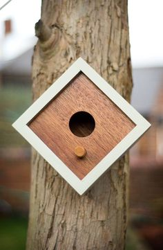 Hand made modern style wooden birdhouse.