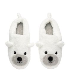 Pile slippers with embroidery and appliqués at front and soft rubber soles.