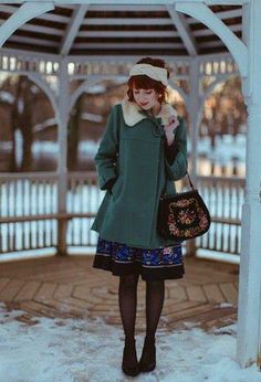 The loveliest shade of green on this statement coat.