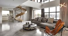 A Sculptural Spiral Staircase Makes A Statement In This Home's Interior | CONTEMPORIST