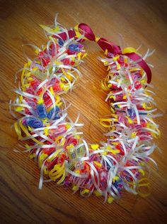 Check out this item in my Etsy shop https://www.etsy.com/listing/228753984/special-occasion-jolly-rancher-candy-lei