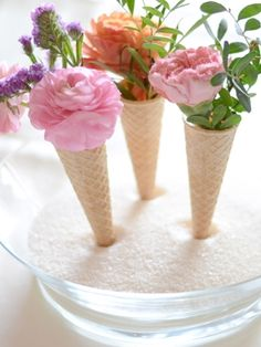 DIY | Fun Florals  |  For a playful twist, display lovely summer flowers in ice cream cones as your centrepieces.    Tutorial: Almalu's Place [http://almalusplaceblog.com/party-diy/diy-ice-cream-cones-centerpiece]